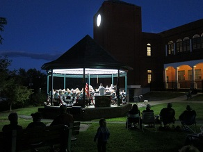 St Johnsbury Band in lighted bandstand for last concert of summer 2016 season